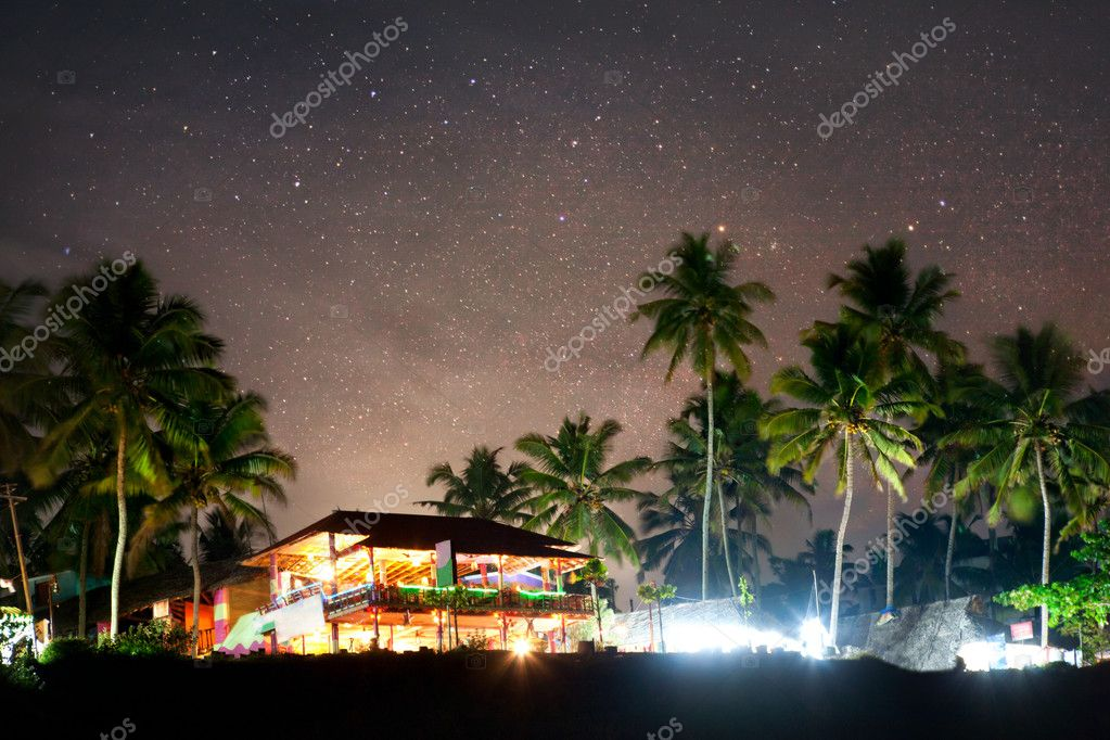 Romantic tropical restaurant on the beach near palm trees at night sky in Varkala, Kerala, India — Stock Photo #11620980