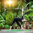 Yoga in the tropic garden — Stock Photo