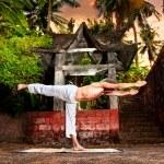 Yoga near temple — Stock Photo