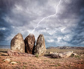 Lightning strikes big stones — Stock Photo