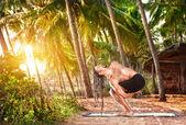 Man with dreadlocks doing yoga — Stock Photo