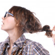 young girl wearing spectacles with a magnificent hairdressspectacles — Stock Photo