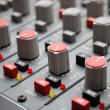 Sound mixer console with highlighted button, pump the volume - Stock Photo