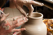 Potter creating earthen jar on the circle — Foto de Stock