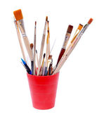 Red glass with brushes — Stock Photo