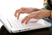 Woman's hands pressing keys on a laptop — Stock Photo