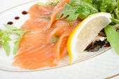 Salmon with lemon on white — Stok fotoğraf