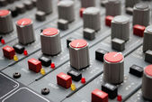 Sound mixer console with highlighted button, pump the volume — Stock Photo