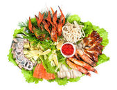 Appetizer closeup of different seafood and vegetables — Stock Photo