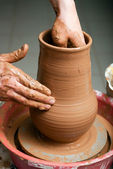Hands of potter — Stock Photo