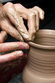 Potter, creating an earthen jar on the circle — Stok fotoğraf