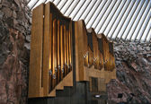 A historic pipe organ in church in rock — Stock Photo