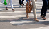 Feet on the pedestrian crossing — Stock Photo