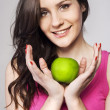 Stock Photo: Young woman with apple