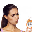 Young woman holding a clock — Stockfoto
