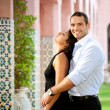 Hispanic couple hugging outdoors - Foto Stock