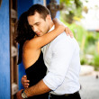 Happy couple hugging outdoors — Stock Photo