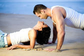 Couple lying down on beach — Stok fotoğraf