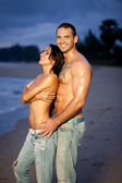 Nude couple on beach — Stock Photo