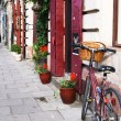 Krakow, Poland - July 12: old red bicycle standing on a street — Stock Photo #11980884