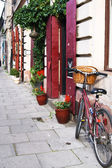 Krakow, Poland - July 12: old red bicycle standing on a street — Stock Photo