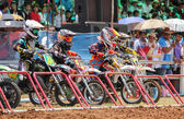 Motocross riders lined up at the start — Stock Photo