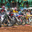 Motocross riders lined up at start gate — Stock Photo #12113325