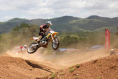 Motocross rider jumping — Stockfoto