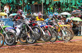 Motocross riders lined up at the start gate — Stock Photo