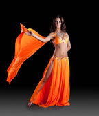 Oriental dancer in orange dress — Stock Photo