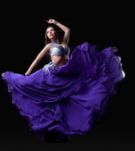 Young woman dancing oriental dance — Stock Photo