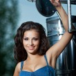 Pretty young woman and truck — Stock Photo
