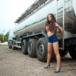 Brunette young woman and truck — Stock Photo