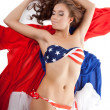 Beauty sexy woman in usa flag bikini on fabric — Stock Photo