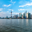 Shanghai skyscrapers at evening near water - Stock Photo