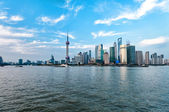 Shanghai skyscrapers at evening near water — Stock Photo