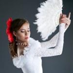 Woman posing in flamenco white costume — Stock Photo