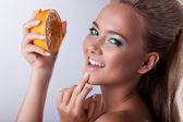 Sexy girl smile with squeeze orange — Stock Photo
