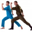 Stock Photo: Two athletic mposing in army costume isolated