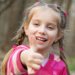 Girl showing a thumbs up — Stock Photo