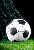 Soccer ball in the net gate — Stock Photo