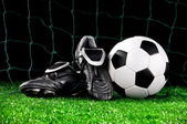 Soccer ball and cleats — Stock Photo