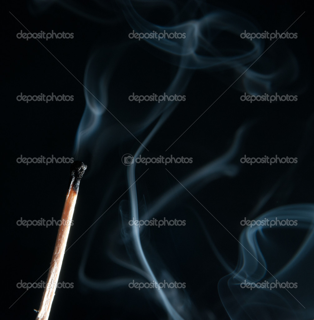 Extinguished the match with smoke on black background  Stock Photo #10801565