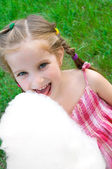 Girl with cotton candy — Stock Photo