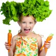 Little sweet girl with a salad on her head — Stock Photo