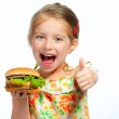 Little girl eating a sandwich isolated — Stock Photo #10881017