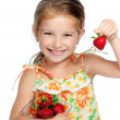 Little cute girl holding a strawberry — Stock Photo #10881428