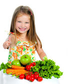 Sweet girl with vegetables — Stock Photo