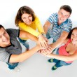 Group of young holding hands — Stock Photo #11691023