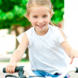 Girl on a bicycle in the park — Stock Photo #11986748